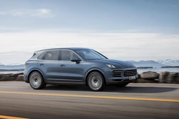 Slide 1 of 56: 2019-Porsche-Cayenne-side-in-motion-01.jpg