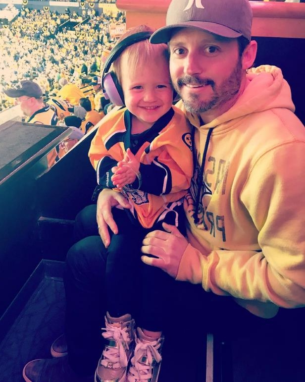 Slide 11 of 24: Brandon Blackstock and daughter River Rose sport matching gear while taking in a Nashville Predators game.