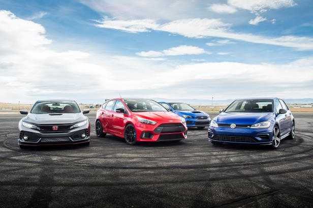 Slide 11 of 94: 2018-Subaru-WRX-STI-Type-RA-2018-Volkswagen-Golf-R-2018-Ford-Focus-RS-2018-Honda-Civic-Type-R-group-on-track.jpg