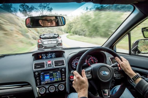 Slide 14 of 94: 2018-Subaru-WRX-STI-Type-RA-dashboard-and-Chris-Walton.jpg