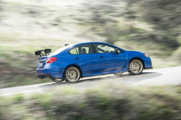 Slide 19 of 94: 2018-Subaru-WRX-STI-Type-RA-side-view-in-motion.jpg