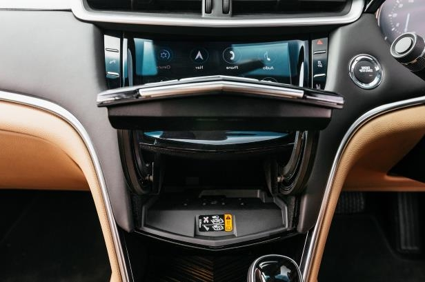 Slide 25 of 27: 2018-Cadillac-XTS-V-Sport-center-stack-storage-compartment.jpg