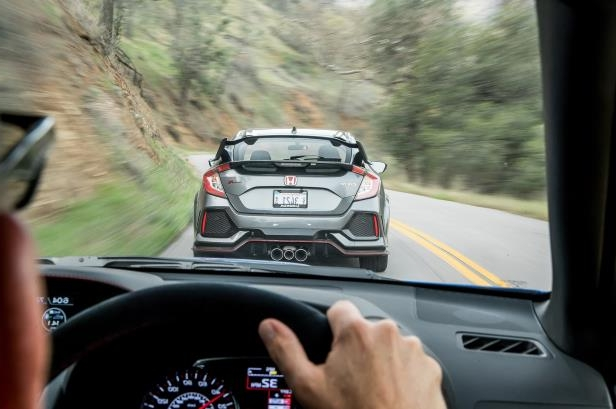 Slide 35 of 94: 2018-Honda-Civic-Type-R-rear-in-motion.jpg