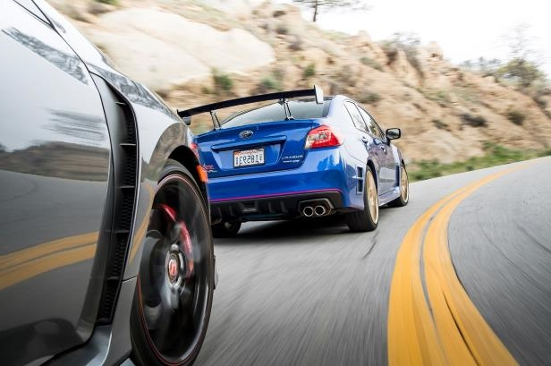 Slide 40 of 94: 2018-Subaru-WRX-STI-Type-RA-rear-view-in-motion.jpg