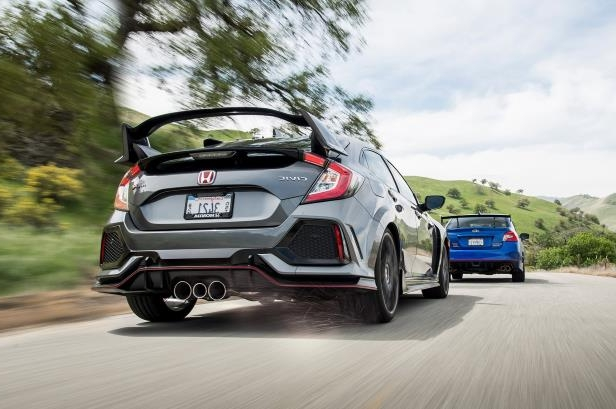Slide 41 of 94: 2018-Honda-Civic-Type-R-2018-Subaru-WRX-STI-Type-RA.jpg