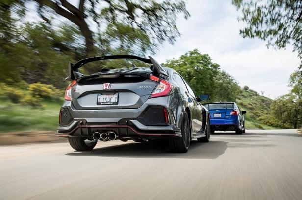 Slide 72 of 94: 2018-Honda-Civic-Type-R-2018-Subaru-WRX-STI-Type-RA-rears-in-motion.jpg