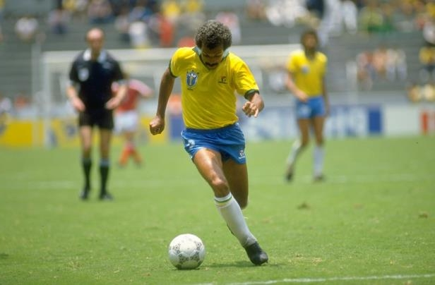 Slide 8 of 24: 16 Jun 1986: Junior of Brazil in action during the World Cup Second Round match against Poland at the Jalisco Stadium in Guadalajara, Mexico. Brazil won the match 4-0. \ Mandatory Credit: Mike King/Allsport