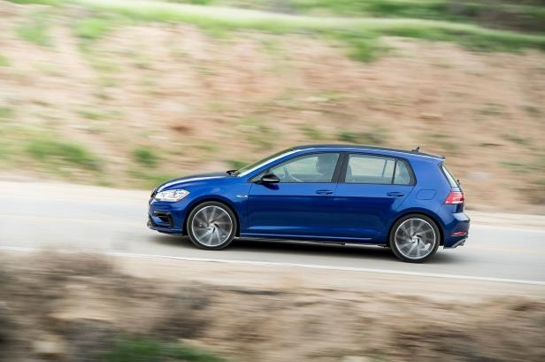 Slide 90 of 94: 2018-Volkswagen-Golf-R-in-motion-side-view.jpg