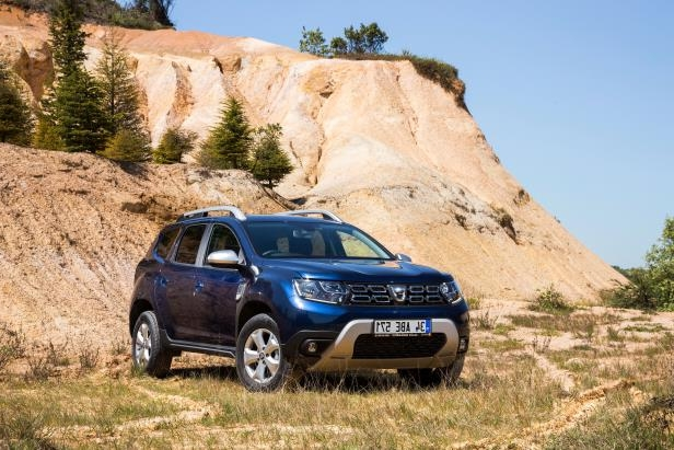 a car parked on the side of a mountain: dacia duster