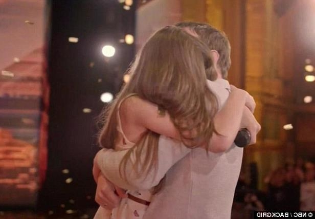 a close up of a person: The emotional schoolgirl hugged her father on stage amid the thunderous applause