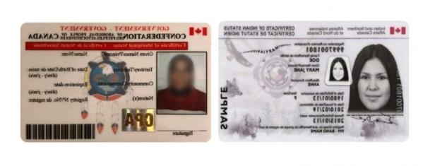 a close up of a piece of paper: A federal government-issued Indian status card on the left, and a card distributed by the Confederation of Aboriginal Peoples of Canada on the right.