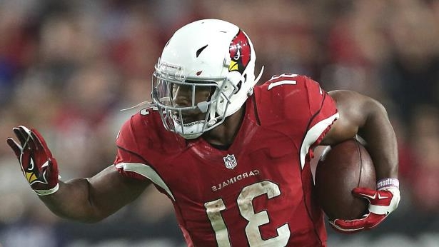 a football player wearing a helmet: David Johnson