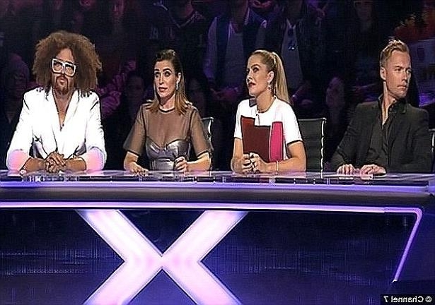 a group of people posing for the camera: X Factor: The American star replaced Guy Sebastian as an X Factor Australia judge in 2013, using the stage during that year's live final to premiere his solo single 'Let's Get Ridiculous'