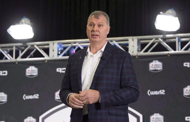 a man wearing a suit and tie: CFL commissioner Randy Ambrosie has spent the off-season traveling across the country to get input from fans, players, owners and sponsors.