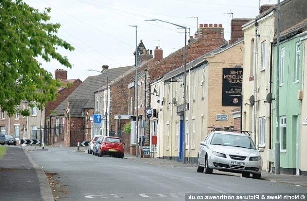 a narrow city street with cars parked on the side of a building: Courtney lives in the village of Hesleden, County Durham, pictured, with her family