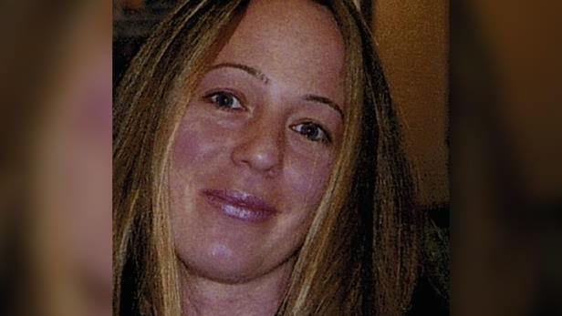 a person smiling for the camera: This photo of Lisa Dudley, who was killed in a targeted attack in 2008, was entered as evidence at the coroners inquest into her death.