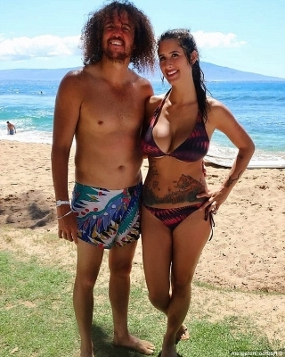 a person standing on a beach posing for the camera: Partner: Redfoo has also found love with chef and road manager Jasmine Alkouri(LEFT), who he now lives with