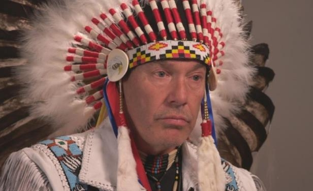 a person wearing a hat: Guillaume Carle, the grand chief of the Confederation of Aboriginal Peoples of Canada.