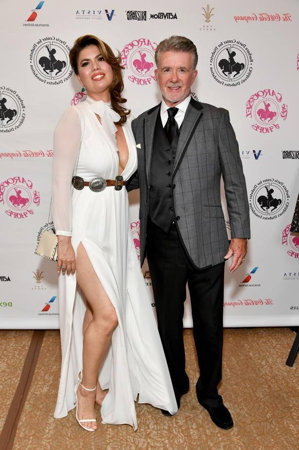Alan Thicke, Tanya Callau are posing for a picture: Alan Thicke and Tanya Callau Thicke attend the Carousel of Hope Ball in Los Angeles on Oct. 8, 2016.