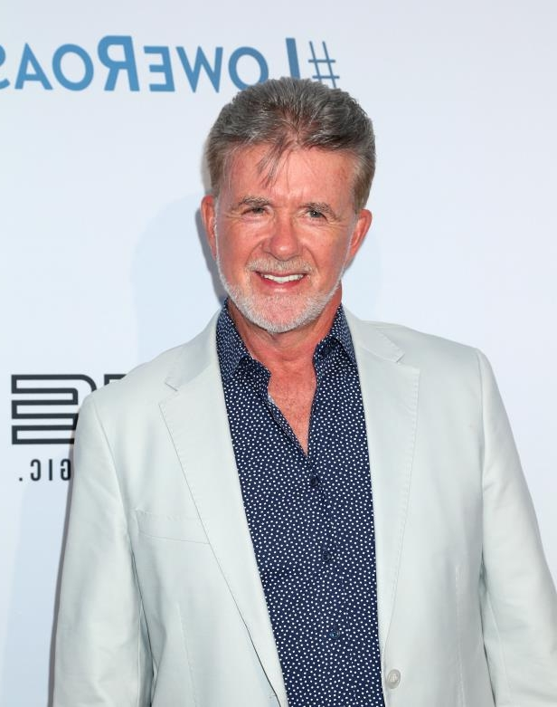 Alan Thicke wearing a suit and tie: Alan Thicke attends the Comedy Central Roast of Rob Lowe in Los Angeles on Aug. 27, 2016.