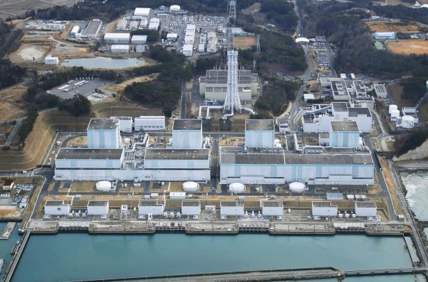 In this February 2018, aerial photo shows Fukushima Dai-ni, or No. 2, nuclear power plant in Naraha, Fukushima Prefecture, northeastern Japan. Tokyo Electric Power Company Holdings said Thursday, June 14, 2018, it was considering dismantling four reactors at the plant, which has never restarted since the 2011 disaster. If Fukushima No. 2 were to be scrapped, the number of workable reactors in Japan would fall to 35, down from 54 before the disaster. (Kyodo News via AP)
