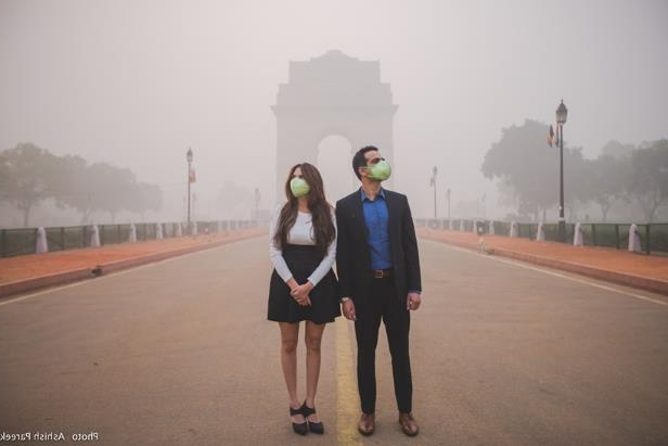 Love in time of SMOG: Delhi photographer's mask-themed couple photoshoot in air pollution goes viral: With the recent rise in air pollution and Delhi being under the blanket of heavy smog, it has been compared to nothing but a 'gas chamber.' So what happens to Delhi's picturesque locations now that are itself a prop, a canvas, theme for any photoshoot? Well, with the love for Delhi's vivid iconography that speaks for itself and has given many couples and photographers their dream photo shoot once, one photographer tried to capture the horror of changing scenarios but with a twist! A couple photoshoot celebrating love but also saving them is their masks.(Source: Ashish Pareek)