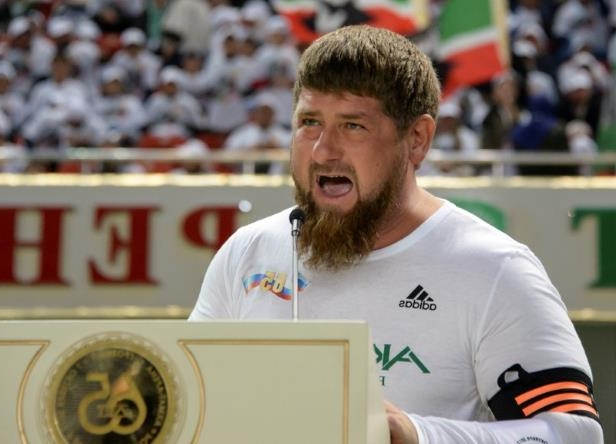 Ramzan Kadyrov standing in front of a crowd: FILE PHOTO: Head of the Chechen Republic Kadyrov speaks before a soccer match in Grozny