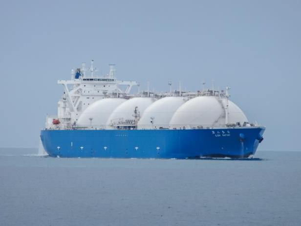 Slide 7 of 16: Singapore Strait, Singapore - November 17, 2013: A large LNG tanker, the Taitar No.2, transits Singapore Strait