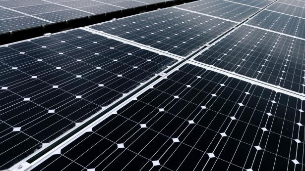 Solar panels stand at the SoftBank Takasago Solar Park, operated by SoftBank Corp.\'s unit SB Energy Corp., in Takasago City, Hyogo Prefecture, Japan, on Tuesday, Feb. 18, 2014.: Canada Pension Plan Offers Country's Largest Green Bond in Debut