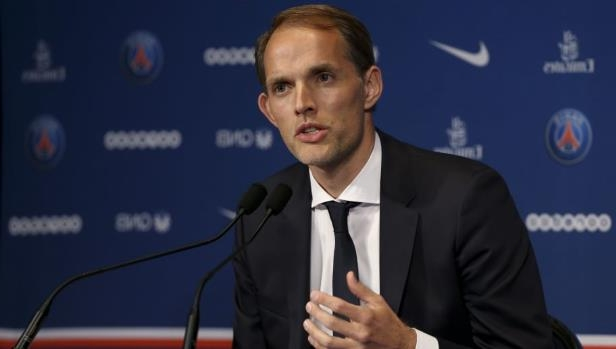 Thomas Tuchel wearing a suit and tie: Paris Saint-Germain Present New Coach Thomas Tuchel