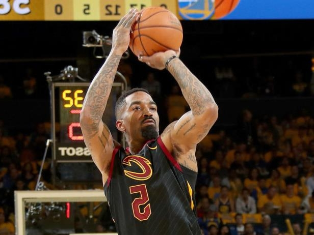 3cd552fe676a Jersey worn by J . R . Smith during Game 1 gaffe . a man holding a  basketball