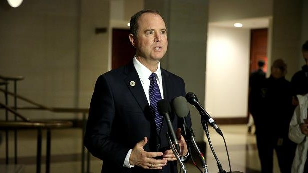 Adam Schiff wearing a suit and tie