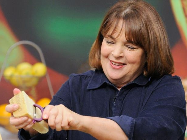 Ina Garten holding a piece of food