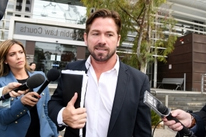 Former AFL player Shannon Grant pleads guilty to assaulting ex-partner