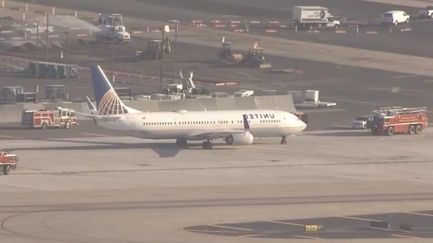 a large passenger jet sitting on top of a runway: Phoenix Fire reported no injuries to passengers, airport officials stated.