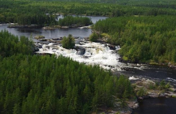 a river running through a body of water: A stretch of boreal forest along the Manitoba-Ontario boundary, part of which is shown in a handout photo, has won international recognition for its pristine environment and connection with Indigenous culture.