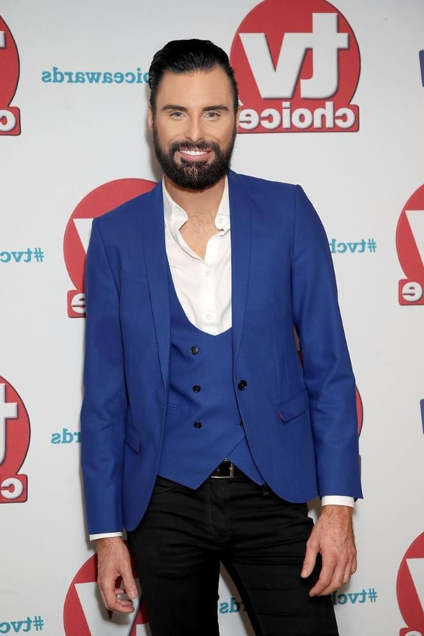 Rylan Clark holding a sign posing for the camera: Rylan Clark-Neal, Celebrity Apprentice, Line Up rumours