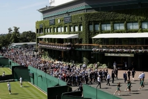 The Latest: Federer unveils new sponsor at Wimbledon