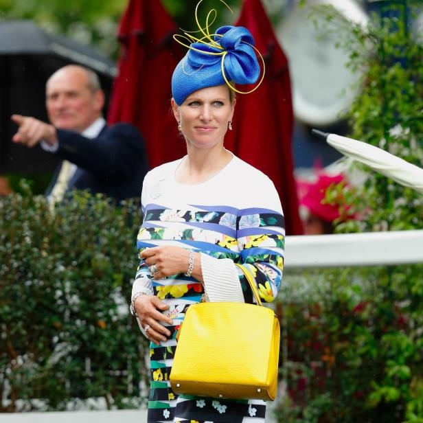 Zara Tindall Is the 1 Royal With a Wardrobe Bolder Than Kate Middleton's: Zara Tindall (formerly Zara Phillips) is a British equestrian, so you might have spotted her in uniform at various events. But when she's not competing, the 36-year-old, who's the daughter of Princess Anne and granddaughter of Queen Elizabeth II, is dazzling alongside the royal family. While she doesn't have an official title, Zara hangs with Kate Middleton, attending the same weddings as the duchess along with the Royal Ascot. Her 2011 nuptials to rugby player Mike Tindall were highly publicized (she wore a considerably classic Stewart Parvin gown).While Zara's an athlete through and through, you'll find that when she practices dressing for the occasion, her eye for style is pertinent. Zara can easily pull off printed coats and fabulous sundresses with avant-garde fascinators some might consider wacky. But that's just Zara's notable appeal when it comes to fashion - there is no tricky trend she won't embrace. Team that up with a collection of luxe designer bags and shoes and the result is a signature look that turns heads. Read on to see what we mean.RelatedKate Middleton's Got Competition From These 9 Stylish Royals