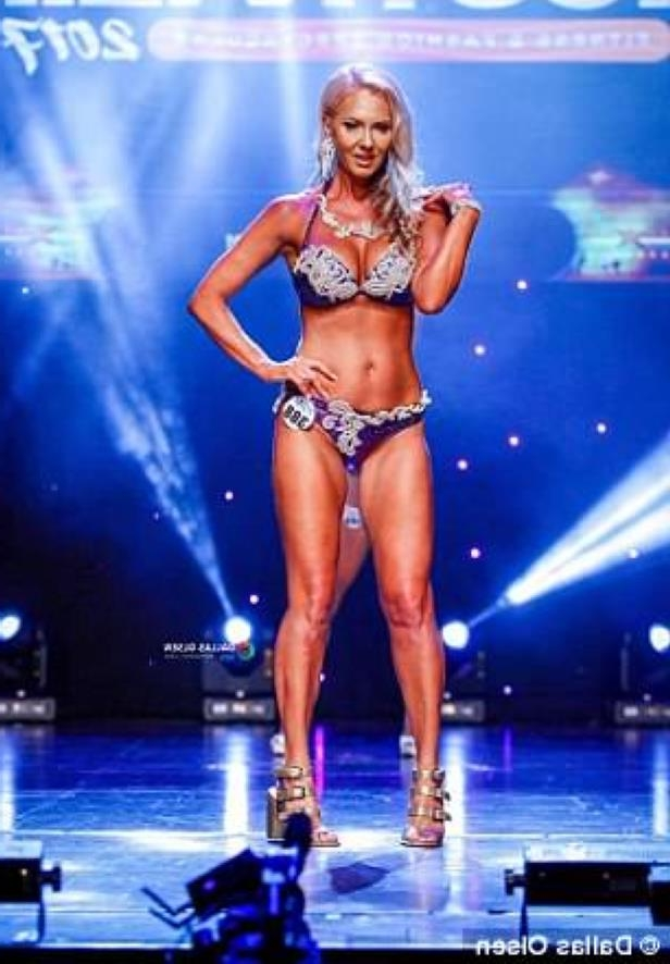 a woman standing on a stage: 'Exercise is a priority, it's my medication and is what will keep me functioning and on top of my game psychology,' the 45-year-old (pictured on the runway) said