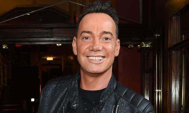 Craig Revel Horwood smiling for the camera: Hello! Magazine