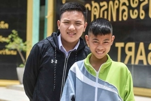 EXCLUSIVE: 'I should be trapped underground... but I had homework to do': Two boys who missed Thai football team's cave trip reveal the twists of fate that saved them from disaster
