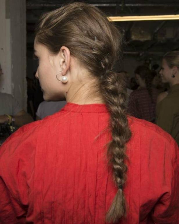 Slide 9 of 14: 2018's take on the braid, school girl plaits hark back to the undone, messy 'do that took you two minutes to achieve before your first class. The good news? This time they're Ports 1961 approved and still take no time at all.'The more pristine, shiny, symmetrical and tidy it looks the more girlish it will seem.,' says Alexa and Rosie H-W's go-to hair guy George Northwood. 'You want to keep this lose and a bit untidy - think the opposite of last years boxer braids. Use super simple hair elastics so they are hardly visible - hair bobbles may be fun but there is no way you are going to look sophisticated with a plait/bobble combo, leave that to kids.'