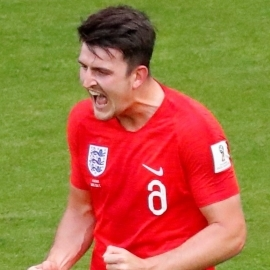 England's Harry Maguire celebrates scoring their first goal