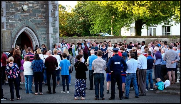 Gardai gather amongst mourners at St. Brigids Church in Dunleer for the Vigil for Cameron Reilly. Photo: Steve Humphreys