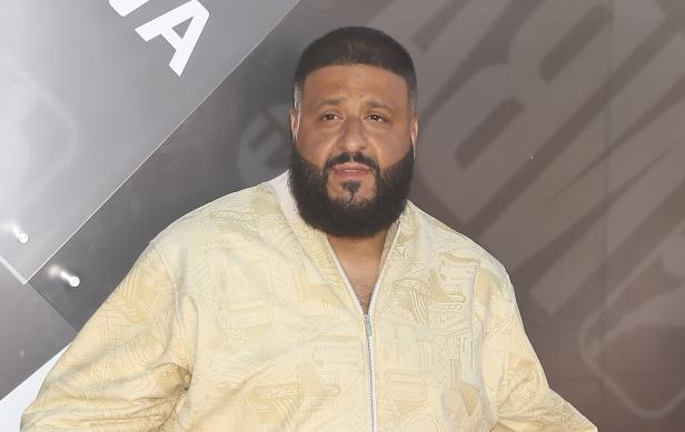 DJ Khaled in a yellow shirt: Michael Tran/FilmMagic