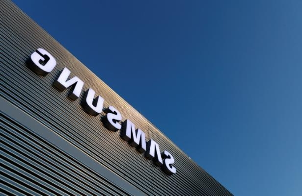 a circuit board: FILE PHOTO: The logo of Samsung is seen on a building during the Mobile World Congress in Barcelona