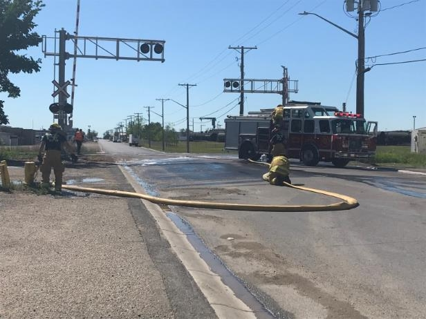 a traffic light on the side of a road: The train was headed to Regina when the fire was reported on Sunday morning.