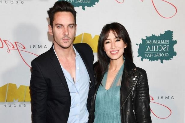 Jonathan Rhys Meyers et al. posing for the camera: Jonathan Rhys Meyers and Mara Lane attend AMBI GALA