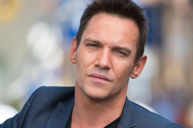 Jonathan Rhys Meyers wearing a black shirt